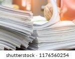teacher's hands are searching... | Shutterstock . vector #1176560254