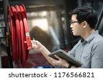 young asian male technician... | Shutterstock . vector #1176566821