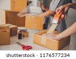 team staff packed in brown... | Shutterstock . vector #1176577234