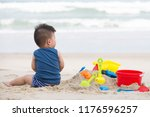 first year old boy play with... | Shutterstock . vector #1176596257
