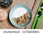 healthy breakfast with granola... | Shutterstock . vector #1176603841