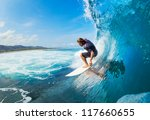 Surfer On Blue Ocean Wave In...