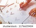 graphic designer drawing sketch ... | Shutterstock . vector #1176635404