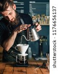 young male barista pouring... | Shutterstock . vector #1176656137