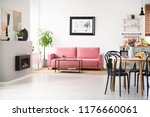 black chairs at table with...   Shutterstock . vector #1176660061