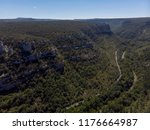 a canyon with a long river ... | Shutterstock . vector #1176664987