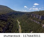a canyon with a long river ... | Shutterstock . vector #1176665011