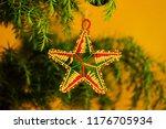 An African Beaded Star Hangs I...
