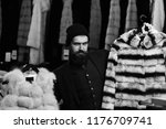 guy with beard chooses furry...   Shutterstock . vector #1176709741