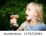 child blong girl posing in... | Shutterstock . vector #1176723481