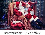 Santa Claus Giving A Present T...