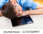young man sleep on the table... | Shutterstock . vector #1176768997