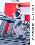 young woman at the gym...   Shutterstock . vector #117677275