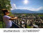 female tourist admiring view of ... | Shutterstock . vector #1176803047