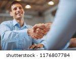 close up of handshake in the... | Shutterstock . vector #1176807784