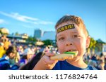 cute australian boy with aussie ... | Shutterstock . vector #1176824764