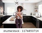 woman at home sitting on... | Shutterstock . vector #1176853714