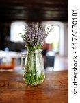 fresh lavender bouquet in glass ... | Shutterstock . vector #1176870181