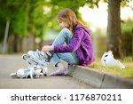 pretty little girl learning to... | Shutterstock . vector #1176870211
