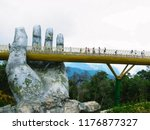 people walking on golden bridge ... | Shutterstock . vector #1176877327