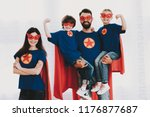 young family in superhero suits.... | Shutterstock . vector #1176877687
