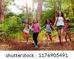 boys and girls running in the... | Shutterstock . vector #1176905491