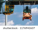 orange yellow cargo crane... | Shutterstock . vector #1176942637