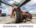 red forklift in container port... | Shutterstock . vector #1176942664