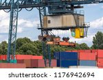 cargo crane positions itself... | Shutterstock . vector #1176942694