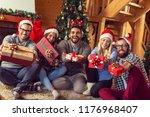 group of friends sitting next... | Shutterstock . vector #1176968407