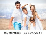 happy couple with kids at the... | Shutterstock . vector #1176972154