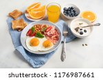 plate of breakfast with fried... | Shutterstock . vector #1176987661