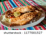 fried trout in a restaurant in... | Shutterstock . vector #1177001527