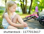 cute little girl sitting on the ... | Shutterstock . vector #1177013617