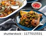 baked chicken legs with peas ... | Shutterstock . vector #1177015531