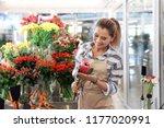 female florist holding... | Shutterstock . vector #1177020991