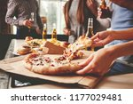 friends taking slices of tasty... | Shutterstock . vector #1177029481