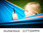 child blond girl playing with a ... | Shutterstock . vector #1177104994