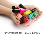 woman hands with nail polishes... | Shutterstock . vector #117712417