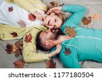 Stock photo autumn woman and happy man on autumn background autumn leaves festival hello autumn and leaf fall 1177180504