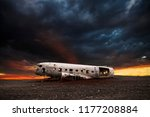 wreck of a white airplane on... | Shutterstock . vector #1177208884