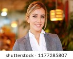 young businesswoman sitting at... | Shutterstock . vector #1177285807