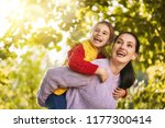 happy family on autumn walk ... | Shutterstock . vector #1177300414