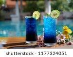blue summer drink at poolside... | Shutterstock . vector #1177324051