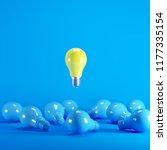 yellow lightbulb floating among ... | Shutterstock . vector #1177335154