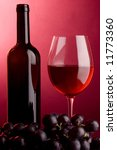 red wine a glass a bottle and grape - stock photo