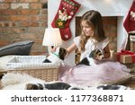 Stock photo little girl with puppies during christmas eve 1177368871