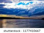 sunset forest river dramatic... | Shutterstock . vector #1177410667