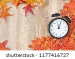 old clock on autumn leaves on... | Shutterstock . vector #1177416727