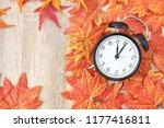 old clock on autumn leaves on... | Shutterstock . vector #1177416811